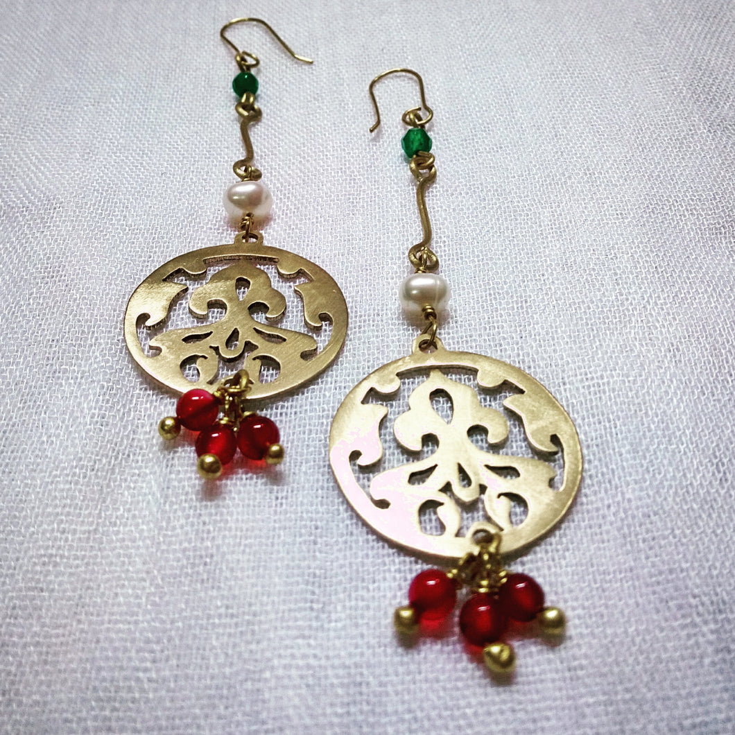 Pearl, Red agate and Jade set up a lovely rhythm in gold plated earrings.