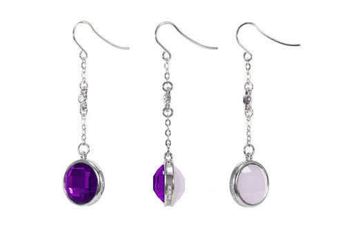 Earrings with purple crystal on one side and glitter stone on the other.