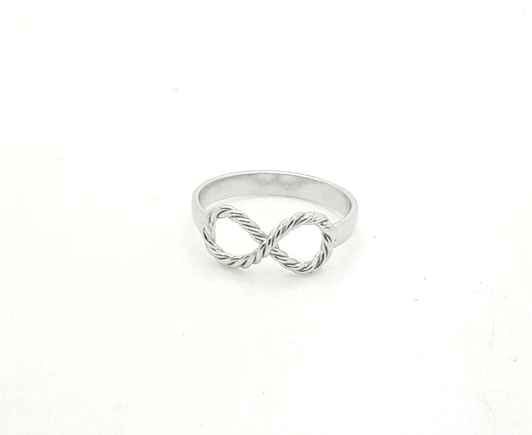 A twist infinity ring in sterling silver.