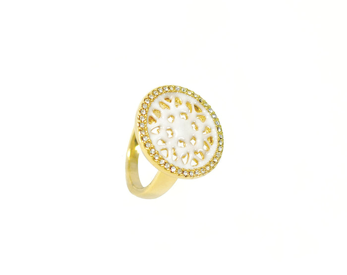 Golden ring with embedded twinkling crystals and small gold pieces.