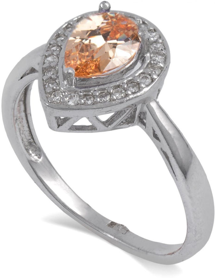 An orange crystal is embedded in the sterling silver and surrounded by crystals.