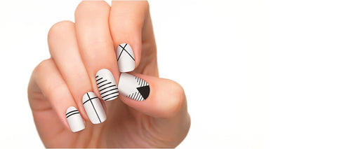 Black and white nail strips in modern simplicity style.