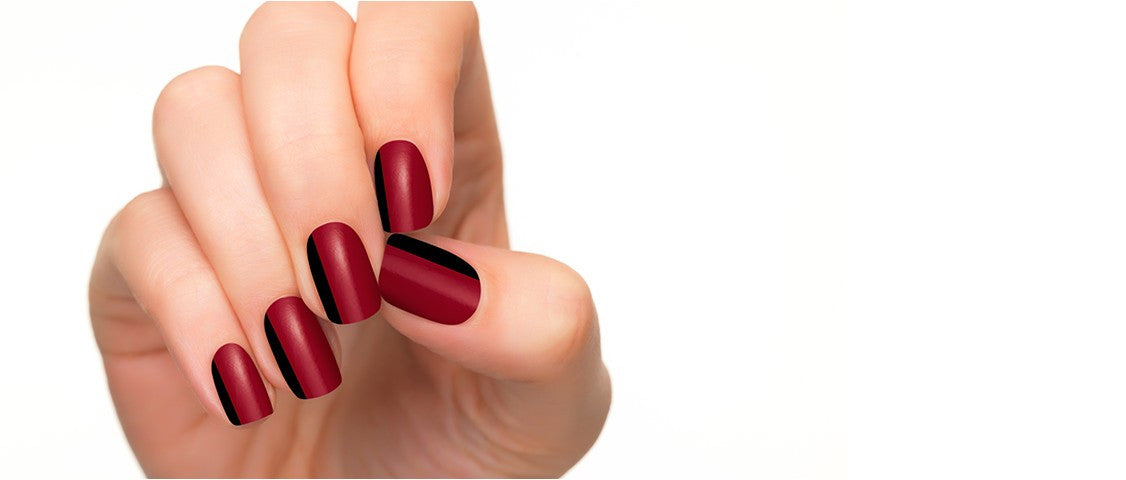 The perfect combination of red and black color in nail polish strips shows an elegant woman.