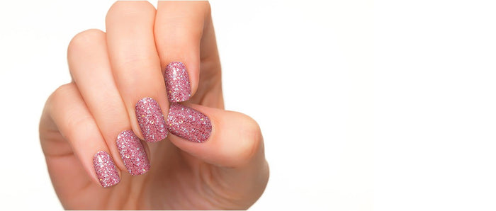 Twinkling nail strips with reddish purple background.