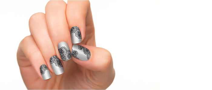 Nail strips with lace pattern in silver background.