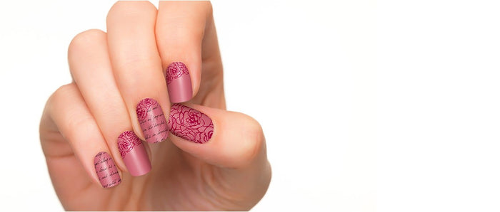 Nail polish strips with different patterns in reddish background.