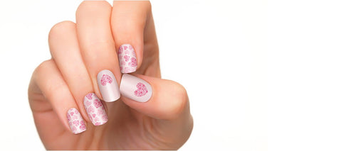 Pink hearts in silver background in nail polish strips.