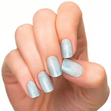 Nail strips of small blue dots in white background.