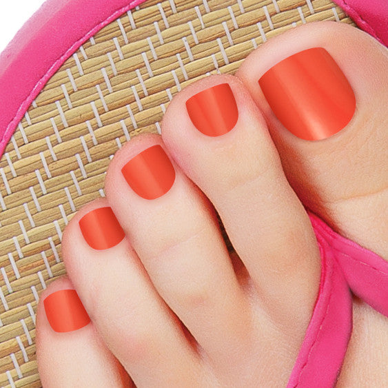 Irresistible reddish orange nail polish strips.