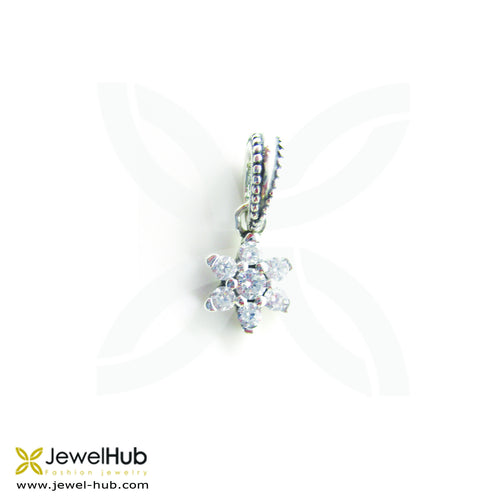 A delicate flower charm with embedded crystals.