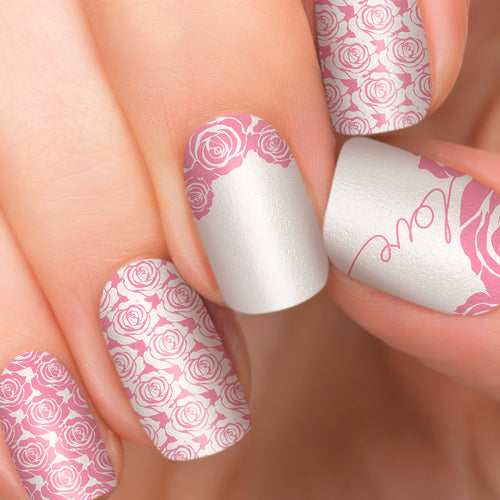 Pink roses nail polish strips in silver background.