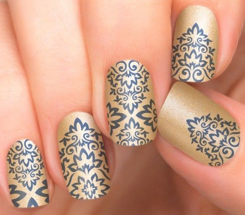 Blue patterns in golden background nail polish strips.