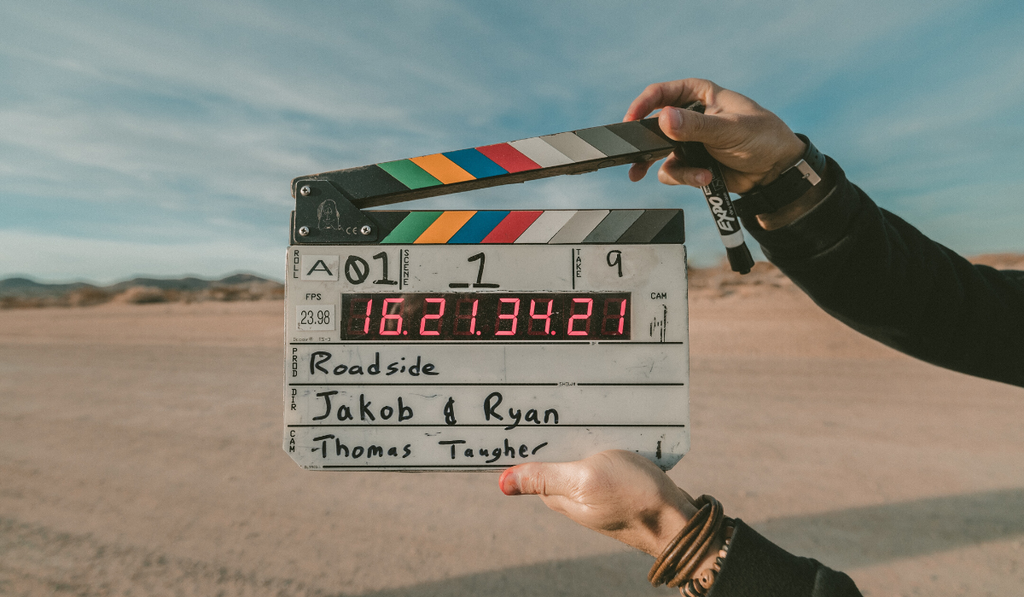 Milk Bottle Shopify webinar -- Going back to basics on Shopify. Image of movie clapper board in desert