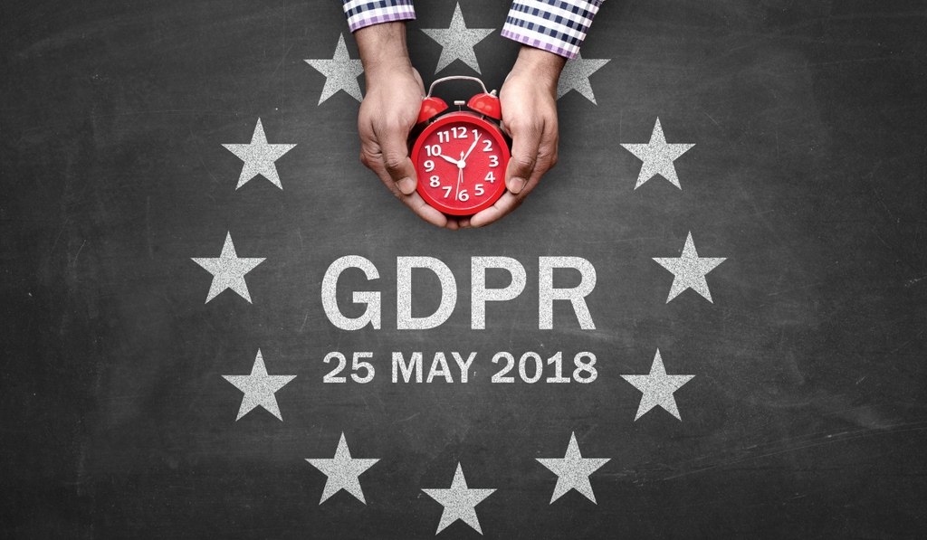 GDPR is around the corner. Hands holding a clock over GDPR 25 May 2018