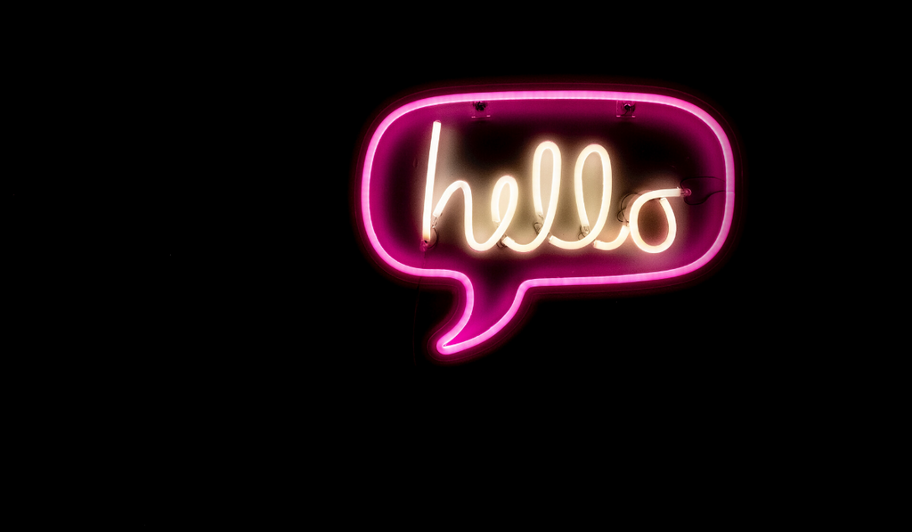 increase sales with personalised emails blog post by Milk Bottle Labs. Image of neon light speech bubble saying hello.