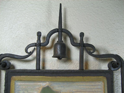 Spanish style eulcalyptus tile in wrought iron frame