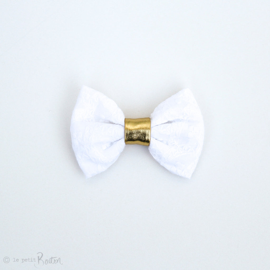 Christmas Embossed Large Bow Hair Clip with Faux Leather Detail.