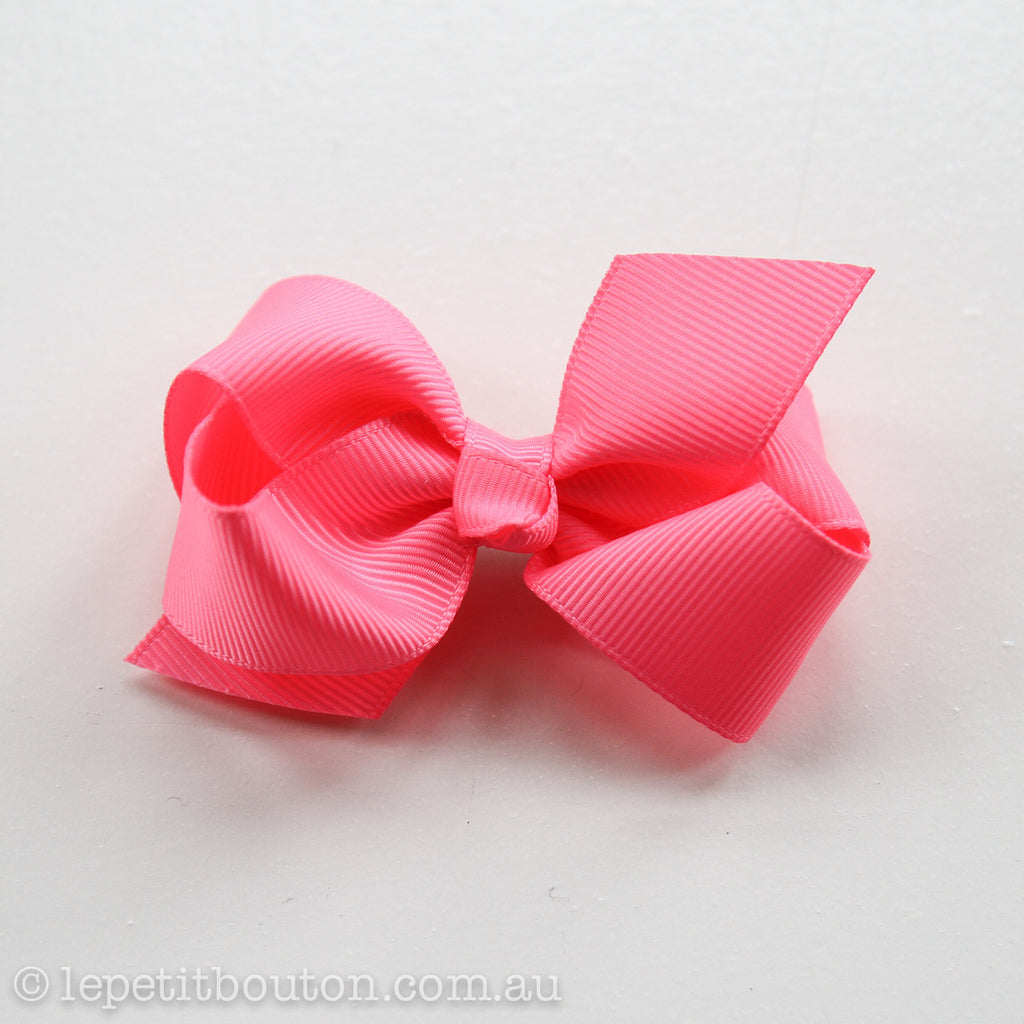 "Small Bow Hair Clip ""Jessica"" Fluoro Passionfruit Pink - Le Petit Bouton"