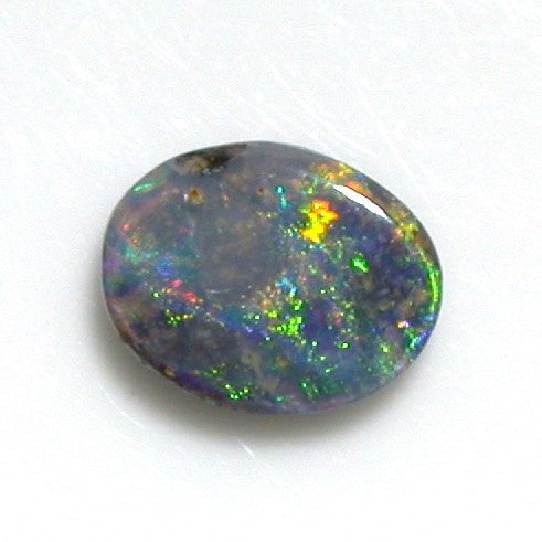 Green and pink solid boulder opal