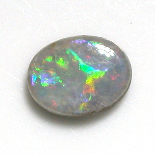 Pink and green solid boulder opal from quilpie