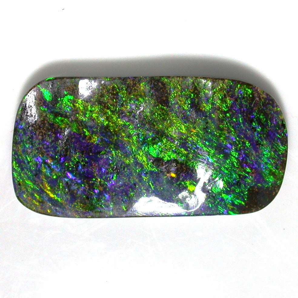 Green , blue and gold solid boulder opal