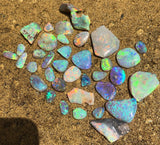 Bright Rubs and Rough Crystal Opal  from Lightning Ridge