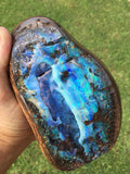 Large green, violet and blue boulder opal polished specimen