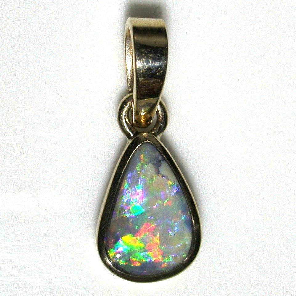 Pink multi coloured solid boulder opal pendant