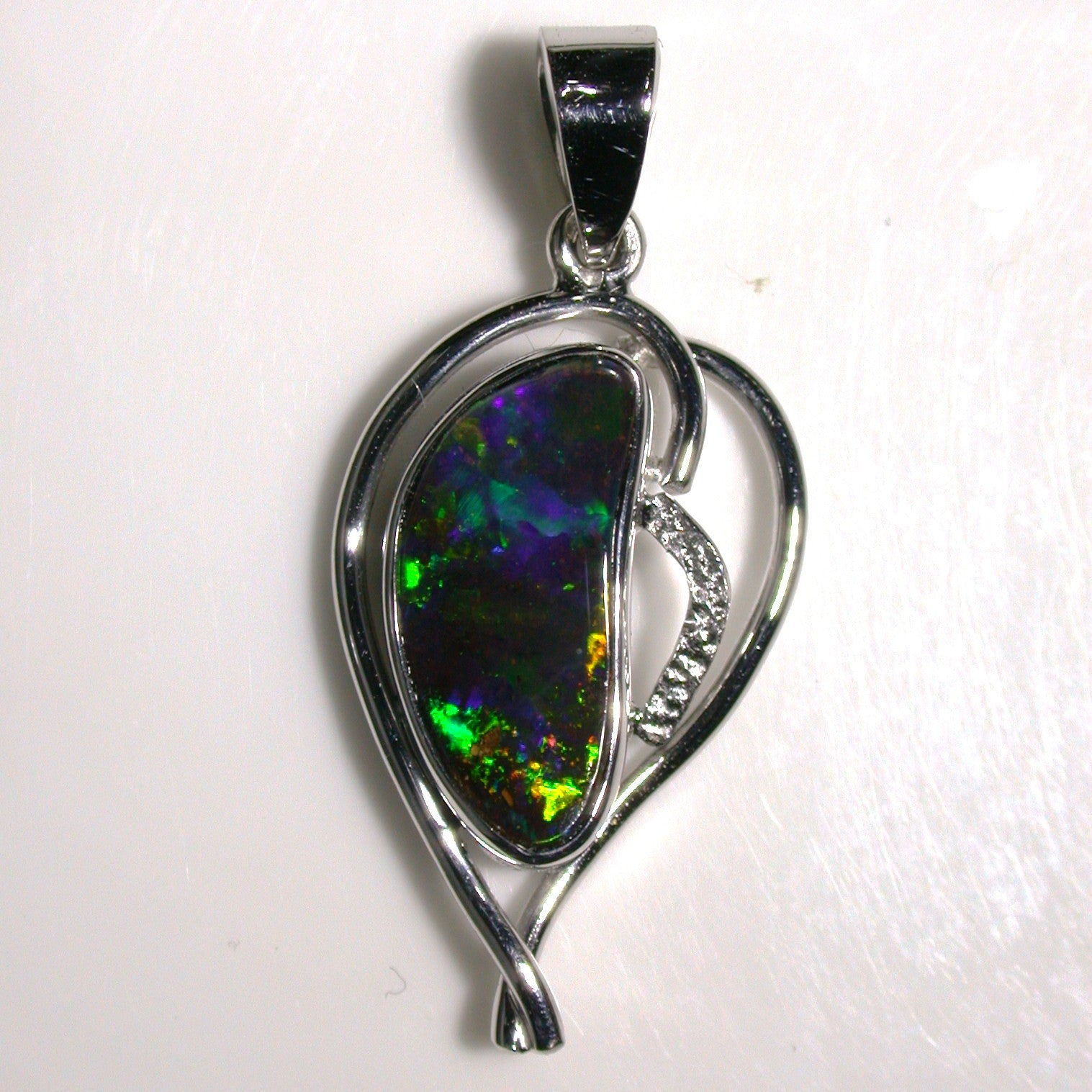 Rolling green and orange Solid boulder opal Pendant in 18K white gold