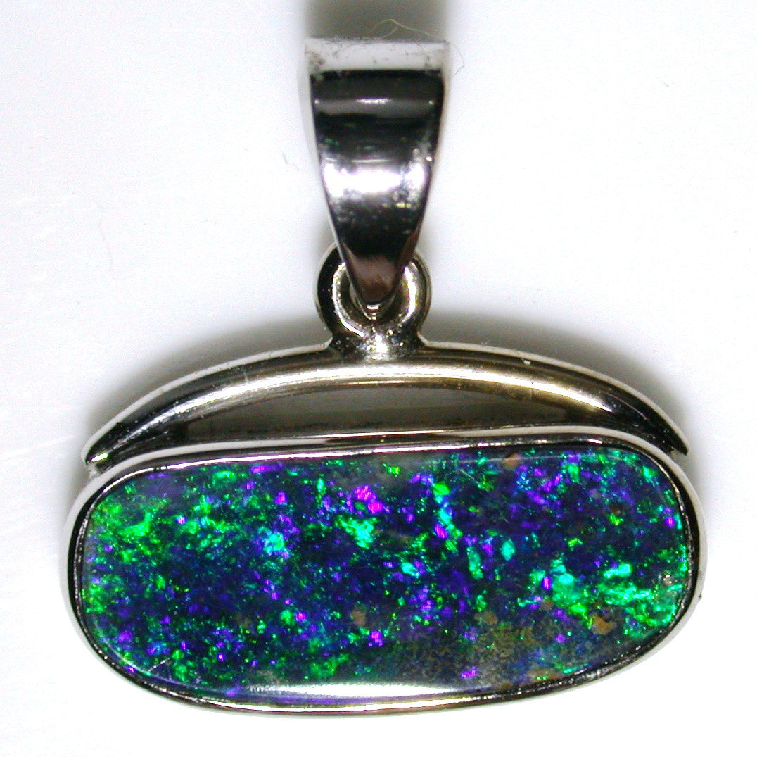 Emerald green solid boulder opal in 18K white gold pendant.