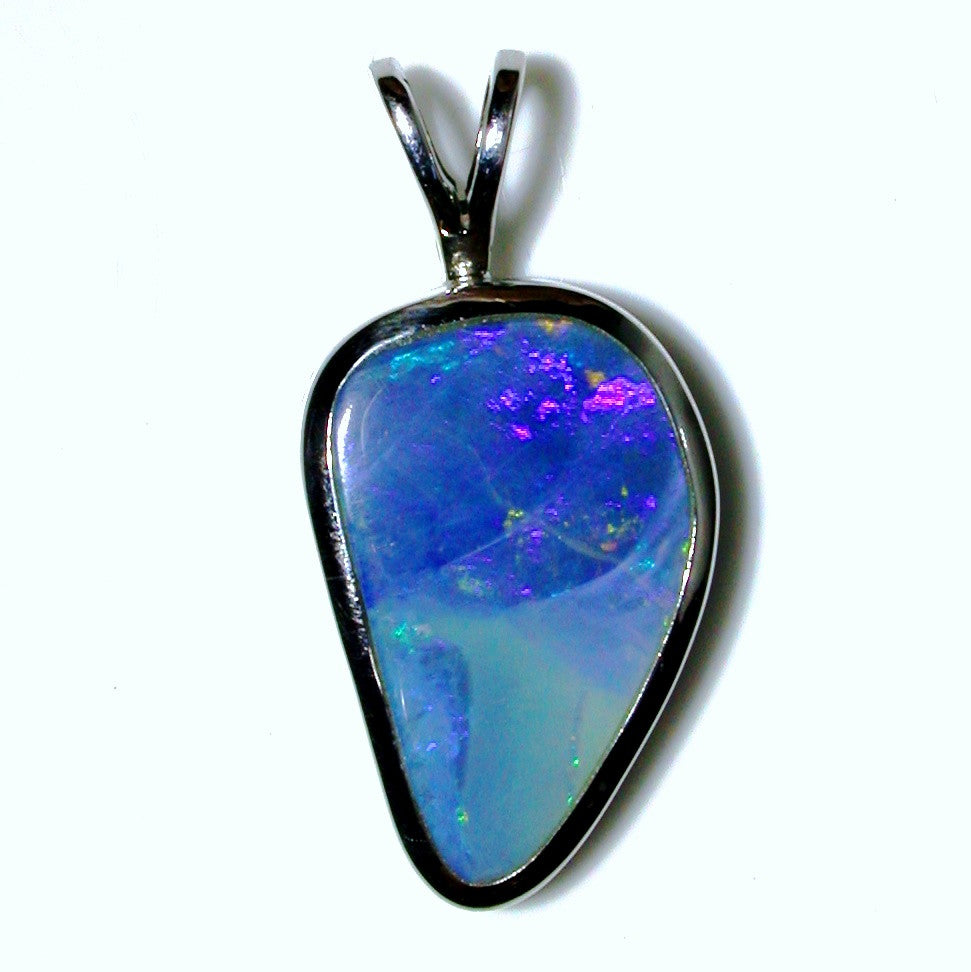 Purple, gold, green multi coloured solid boulder opal pendant
