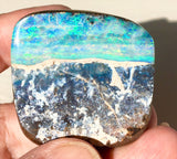 Multi Coloured boulder opal polished speciman