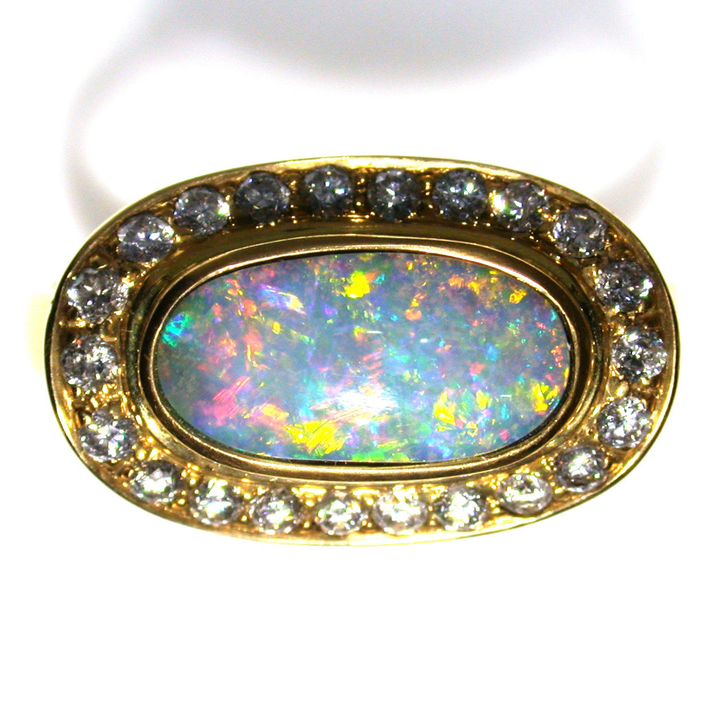 Bright multi coloured solid boulder opal 18k Ring