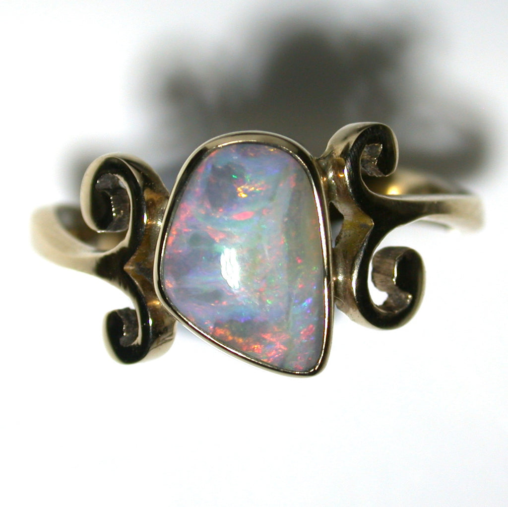 Pink multi coloured solid boulder opal from Quilpie , 9k Ring