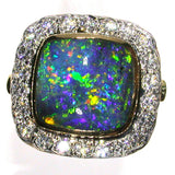 Green, gold, blue and orange solid black boulder opal from Quilpie , 18K Ring