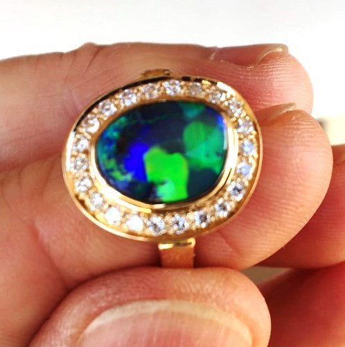 Green, Blue and Orange solid black boulder opal from Quilpie , 18k Ring