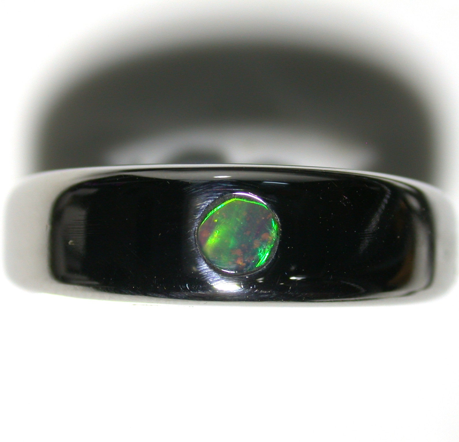 Green and multi coloured solid  boulder opal from Quilpie