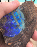 Rough boulder opal beautiful blue green pattern