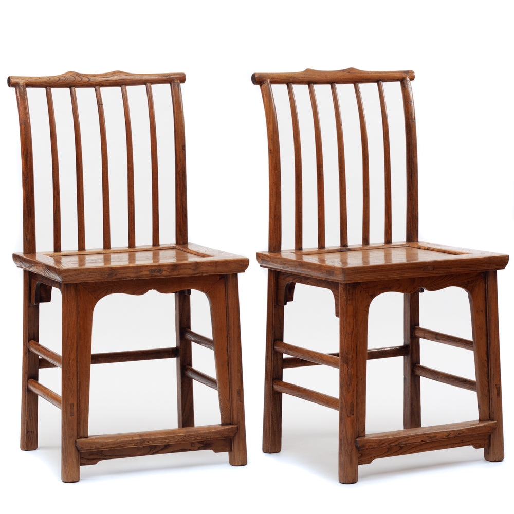 Side chairs with rail back