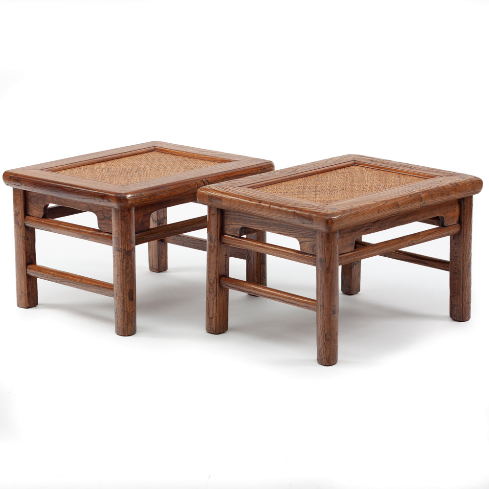 Low rectangular stools with cane seat