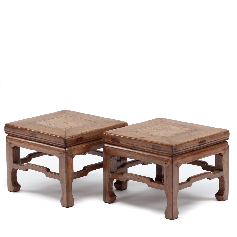 Low stools with humpback stretchers