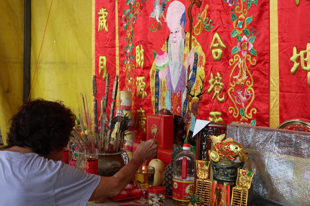 People offer joss sticks
