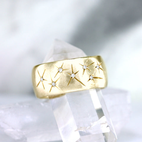 Starlight wide band with white diamonds and 14K yellow gold