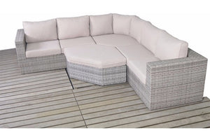 A corner angle grey rattan garden sofa with thick beige cushions and glass topped coffee table from Gardenbox
