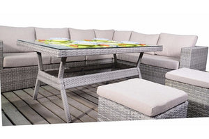 Glass topped dining set and grey rattan corner sofa with three footstools from Gardenbox.co.uk