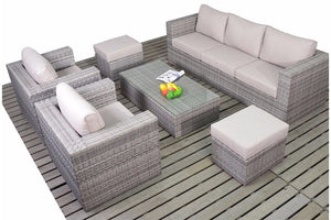 Two chairs, a three seater sofa and two footstools all with beige cushions and grey rattan frame by Gardenbox