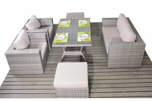 Outdoor seating for 6 adults on this grey rattan sofa set with glass topped dining table by Gardenbox