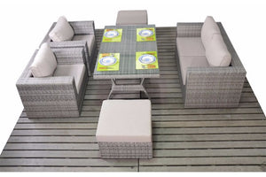 Two seater outdoor dining sofa, two chairs and two foot stools plus a glass topped dining table all in grey rattan