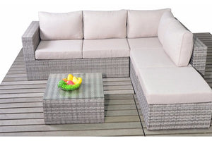 Two sofas a footstool and coffee table in grey rattan with beige cushions from Gardenbox