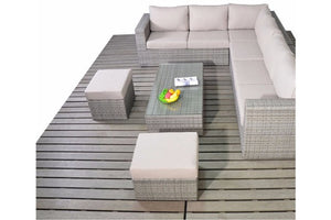 Glass top coffee table, two footstools and large corner sofa in grey rattan with beige cushions by Gardenbox